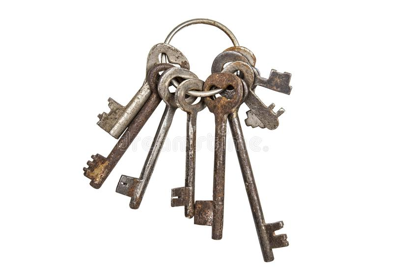 Bunch of old vintage keys isolated on white. Safety and security concept royalty free stock photography