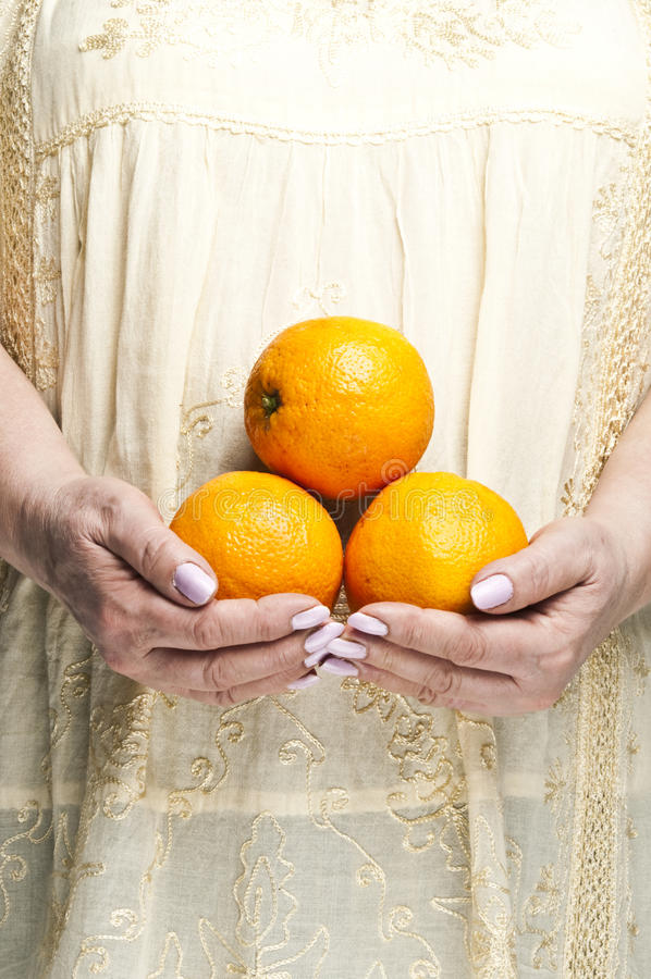 Download Bunch of orange fruits stock photo. Image of female, fruits - 18422438