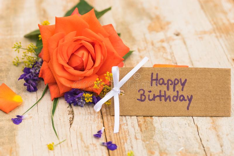 Happy Birthday card with beautiful bunch of rose flower on wooden background stock photos