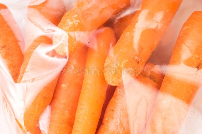 Bunch of organic Carrots, wrapped in plastic stock images