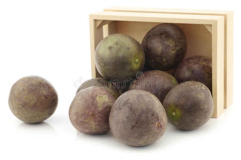 Bunch of passion fruits in a wooden box royalty free stock photo