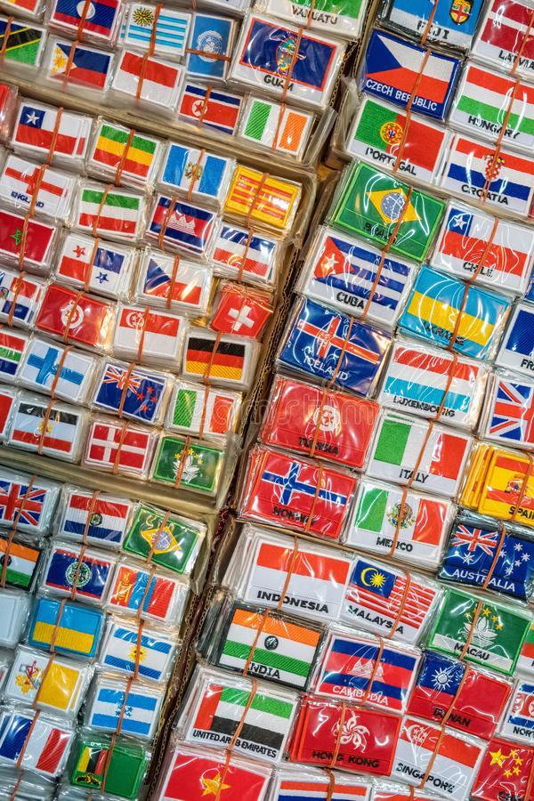 Bunch of patches with world country flags. Embroidered flags background stock photos
