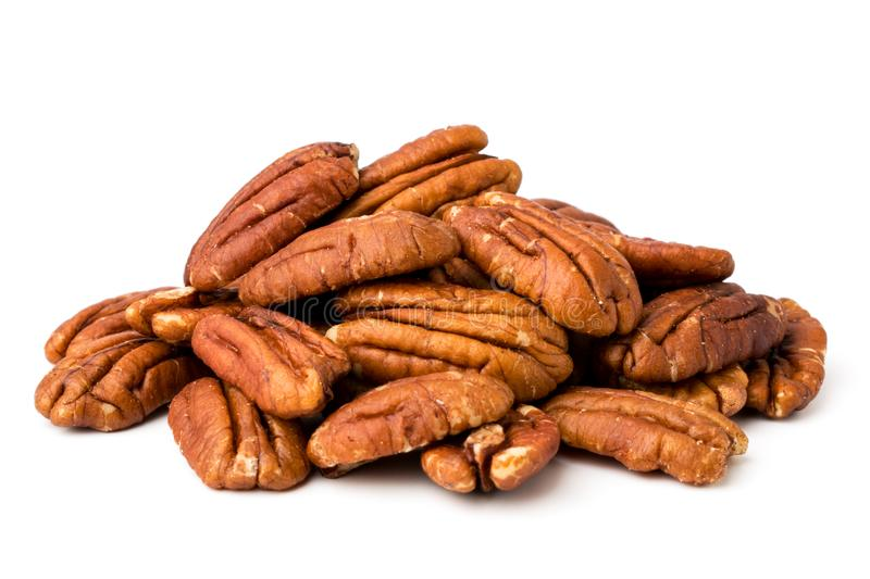 A bunch of peeled pecans on a white, isolated. royalty free stock photos
