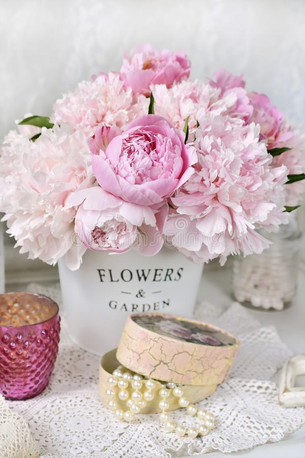 Bunch of peony in shabby chic style interior royalty free stock photos