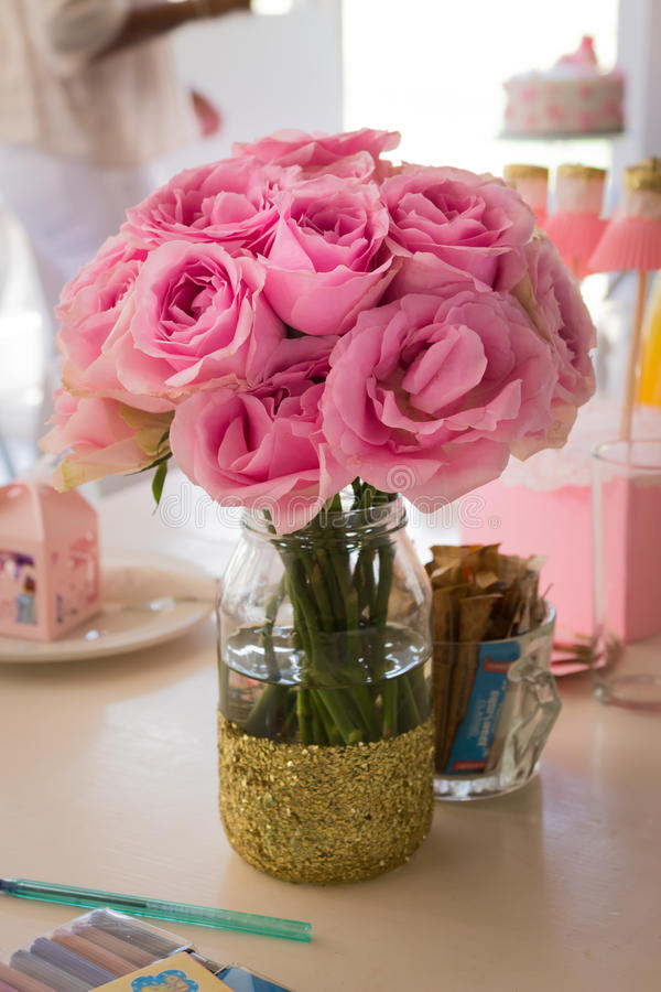Bunch of pink roses in a glass vase stock photography