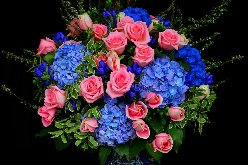 Bunch of pink roses and hydrangea flowers stock image