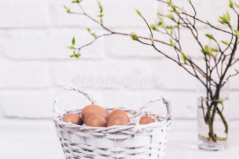 Bunch of Poultry Egg in White Wicker Basket royalty free stock photo