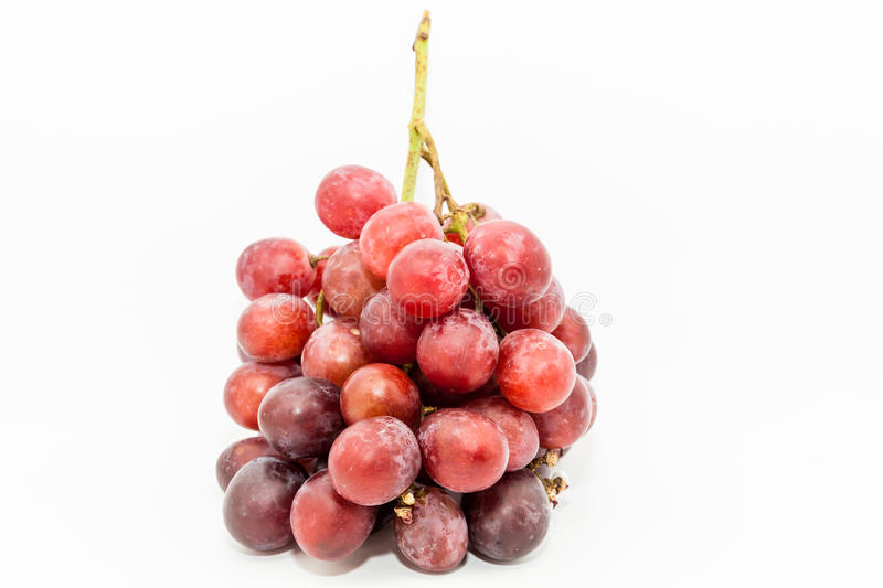 Bunch of red grapes. Big red grapes isolated in white background stock image