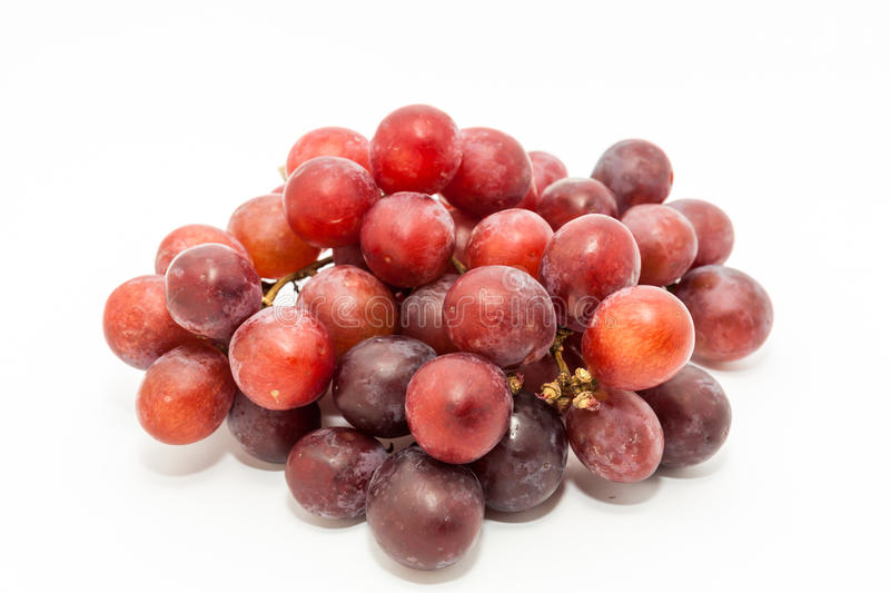 Bunch of red grapes. Big red grapes isolated in white background stock images