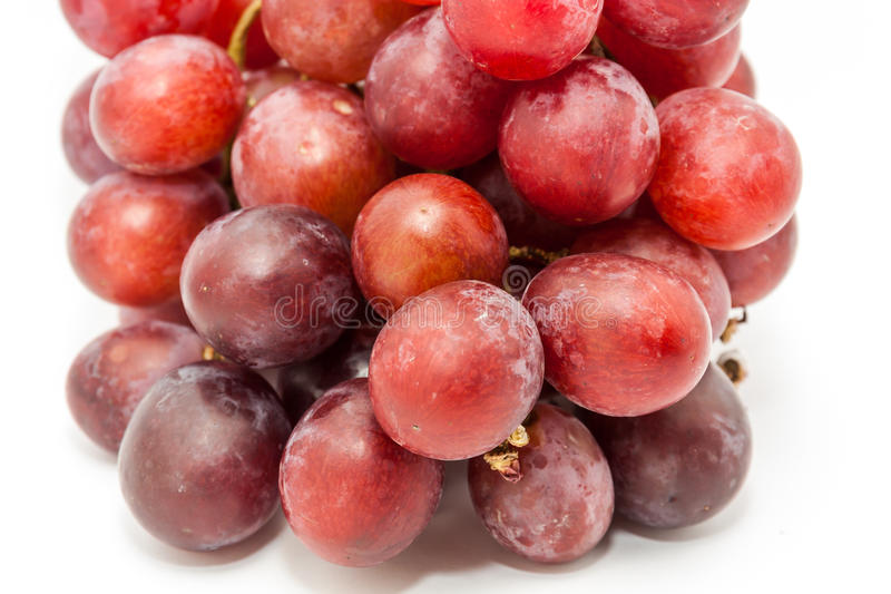 Bunch of red grapes. Big red grapes isolated in white background royalty free stock image