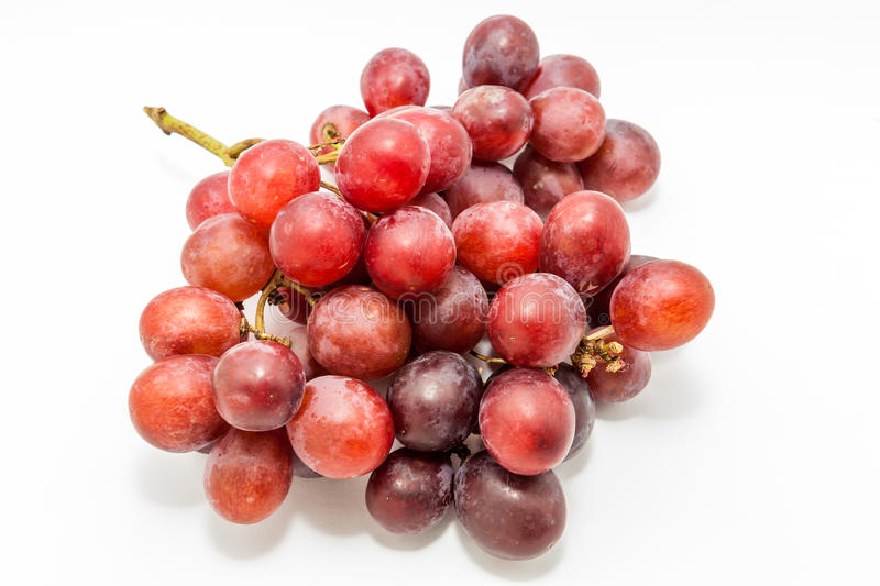 Bunch of red grapes. Big red grapes isolated in white background stock photos