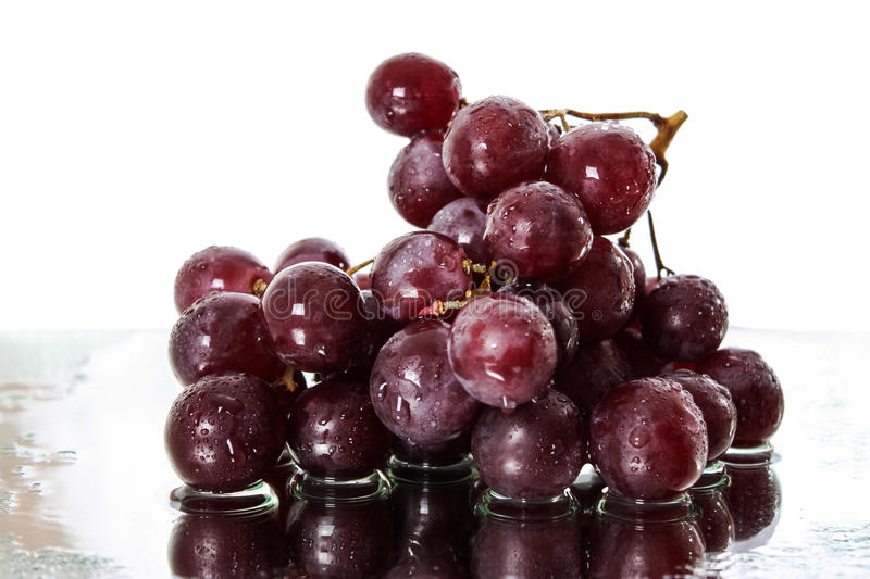 Bunch of red grapes. On Mirror Surface stock images