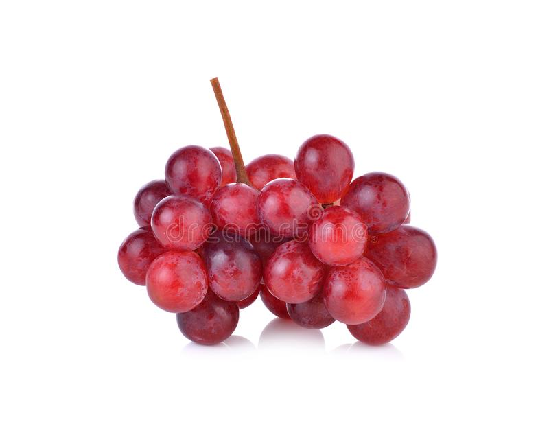 Bunch of red grapes on white background. Bunch of red grapes on a white background royalty free stock photo
