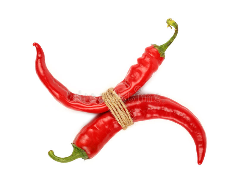 Bunch of red hot chili peppers isolated on white royalty free stock images