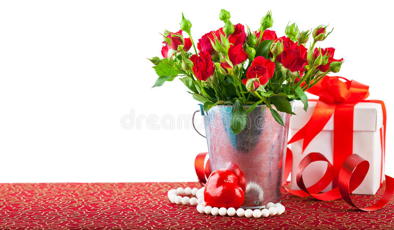 Bunch Red Roses With Gift And Heart Stock Photo