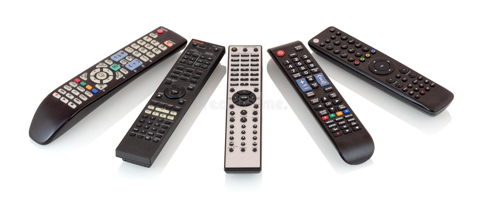 Bunch of remote controls for TV , Blu Ray player, satellite receiver, home cinema amplifier isolated on white background. royalty free stock photography