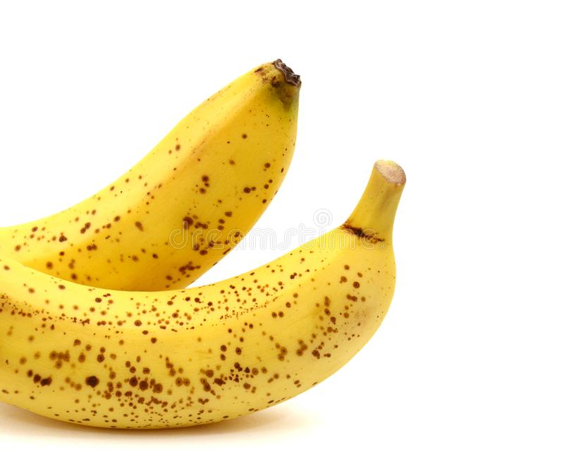 A bunch of three ripe bananas. Close-up. White isolated background. royalty free stock images