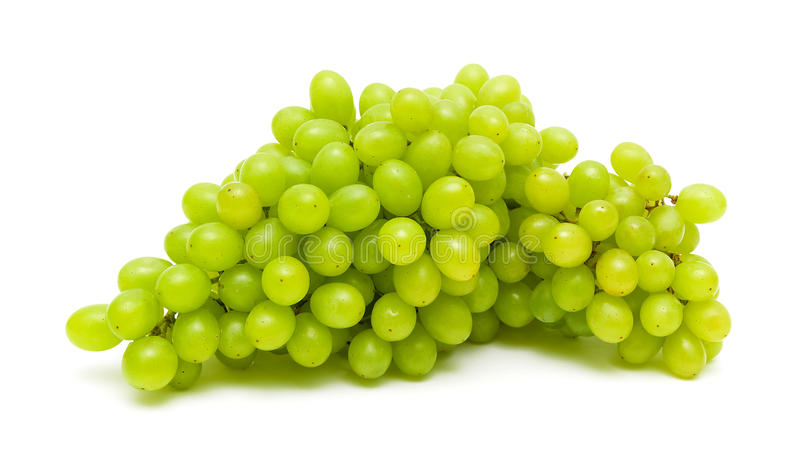 bunch of ripe and juicy green grapes close-up on a white background stock photos