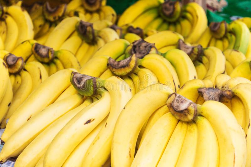 Bunch of ripened bananas at grocery store royalty free stock photography