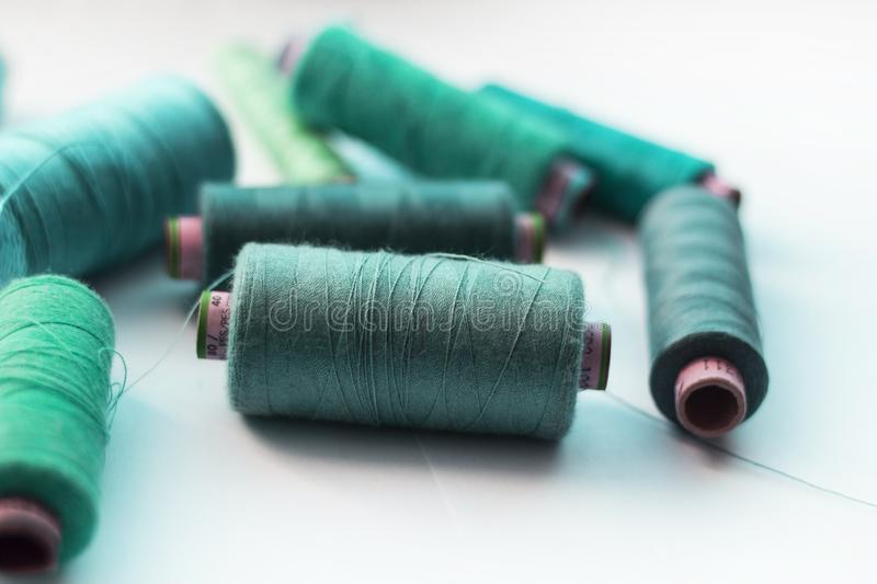 A bunch of sewing thread reels. A closeup photo of colorful sewing thread reels stock images