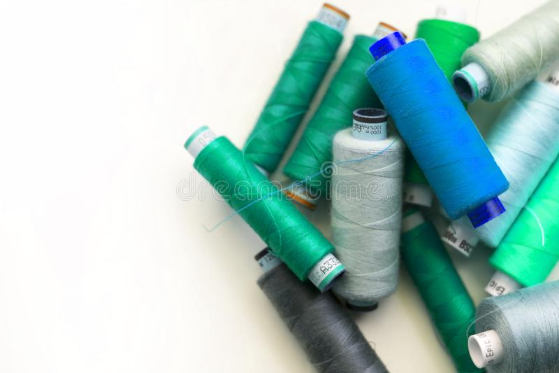 A bunch of sewing thread reels. A closeup photo of colorful sewing thread reels stock photos