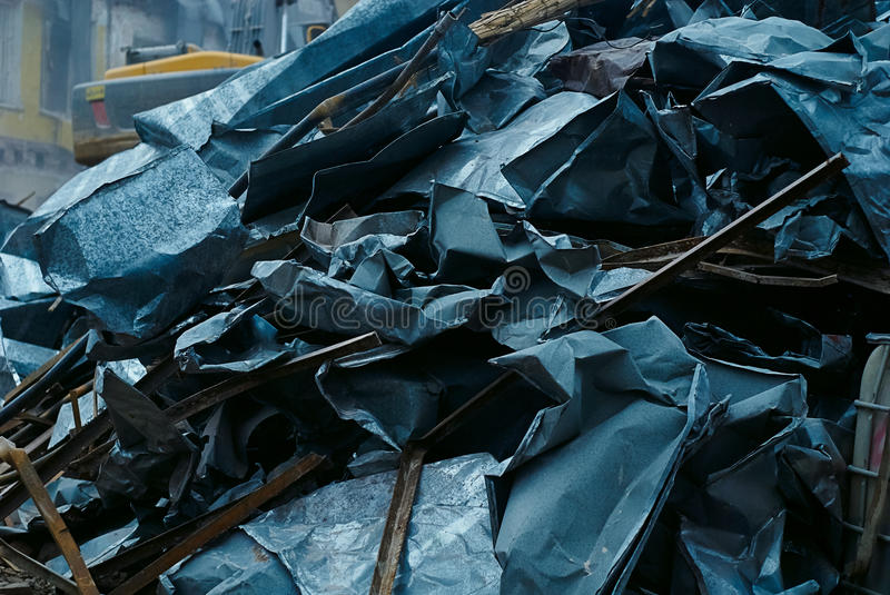 Bunch of sheet metal, metal scrap, dismantled pieces sheet metal of old roof. Ecology problems stock images