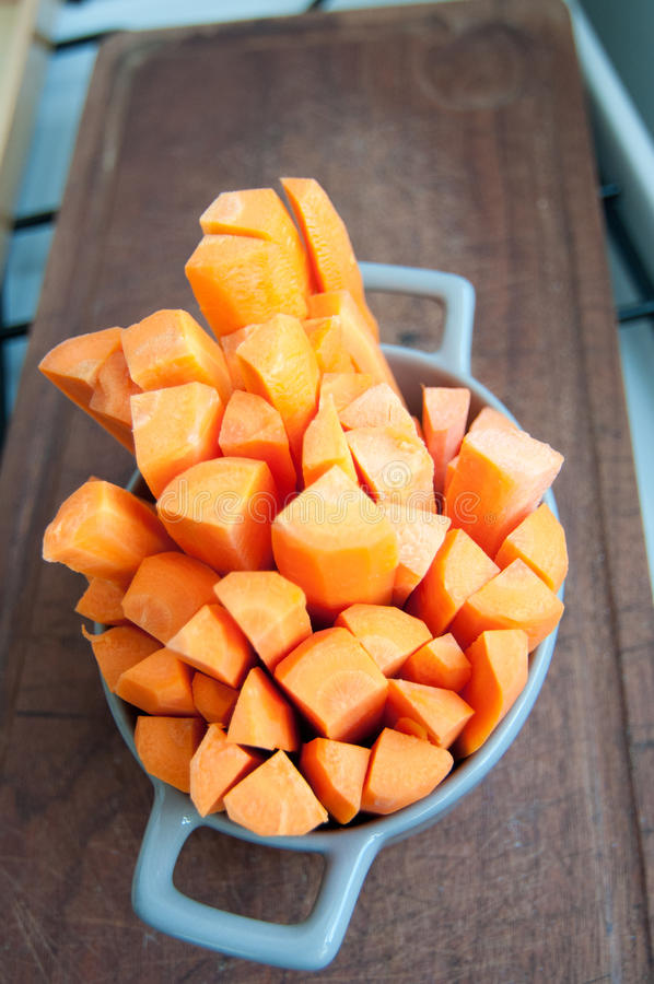 Bunch of sliced carrots in a bowl royalty free stock photos