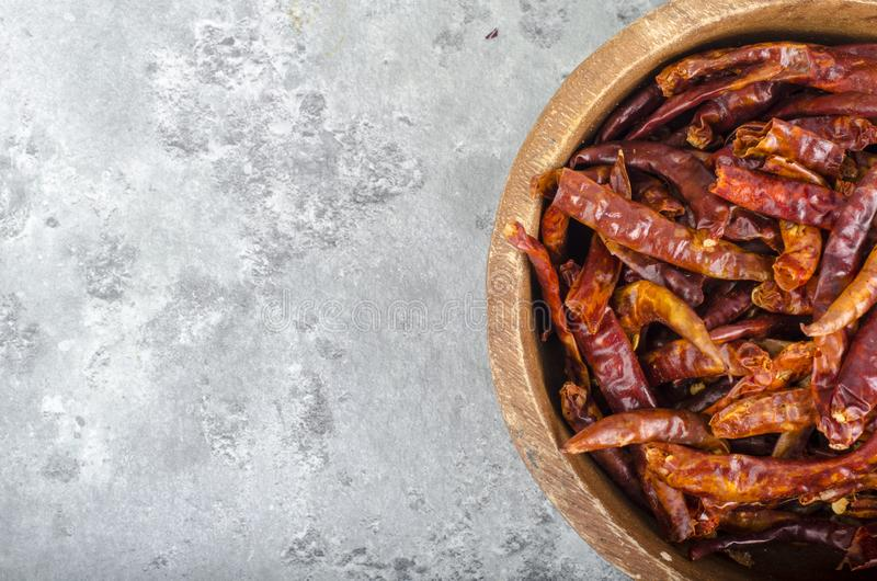 Bunch of small dried red chili peppers stock images