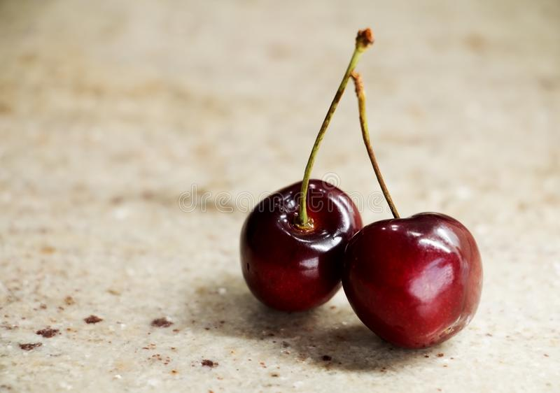 Bunch of sweet cherries on a granite table royalty free stock photos