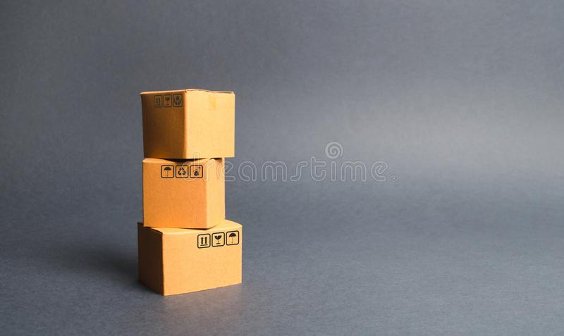 A bunch of three cardboard boxes. The concept of products and goods, commerce and retail. E-commerce, sales and sale of goods royalty free stock photos
