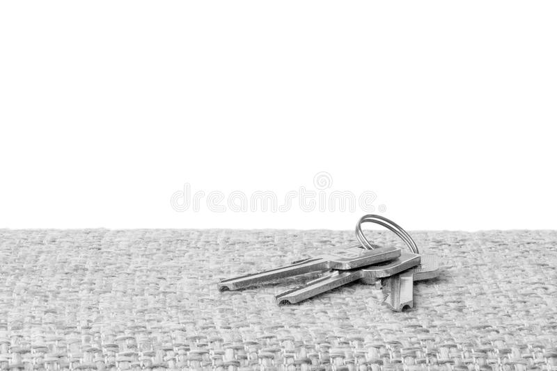 Bunch of keys black white. Bunch of three keys black white isolated white background royalty free stock photography