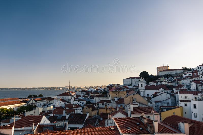 Aerial view of portuguese orange roofs and houses along the sea at sunset in the southern europe, Porto, Portugal. A bunch of typical houses in the old district royalty free stock images