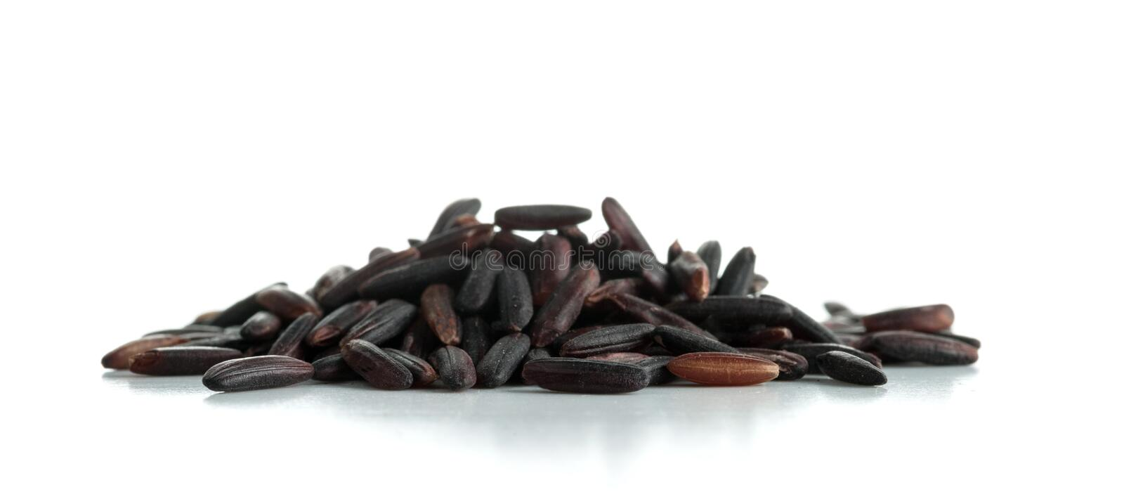 A bunch of unpolished black rice grains isolated on white stock photography