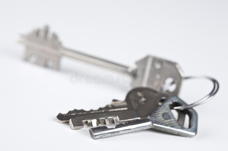 Bunch of various metal keys. Isolated bunch of four various metal keys over white royalty free stock photography