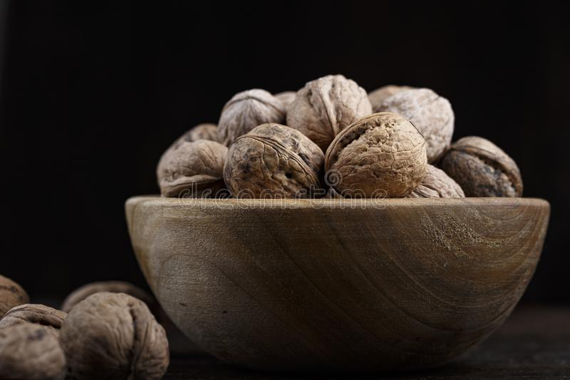 A bunch of walnuts in a bowl royalty free stock photography
