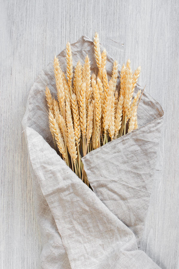Bunch of wheat on the table royalty free stock photography