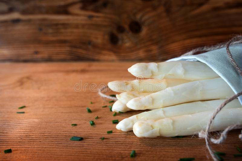 Bunch of white asparagus on wood royalty free stock images