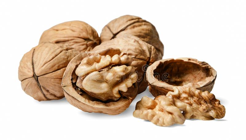 A bunch of whole and chopped walnuts. White isolated background. royalty free stock images