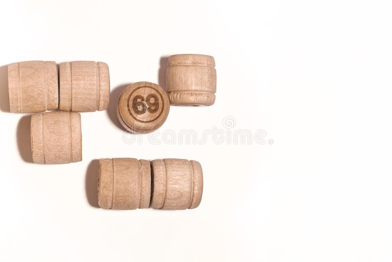 Bunch of wooden barrels with numbers on lotto game .Playing games in lotto. number 69. royalty free stock photos