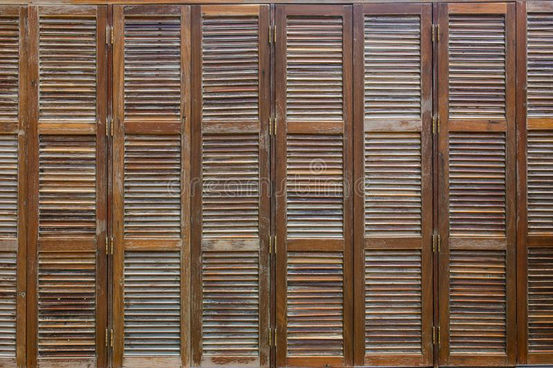Bunch of wooden window shutters pattern background. Restaurant cafe warehouse decor stock photo