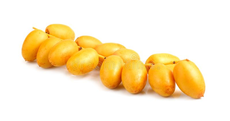 Bunch of yellow raw date fruit or medjool dates Phoenix dactylifera from the palm tree isolated on white background royalty free stock image