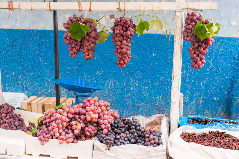 Bunches of grapes. On the market stock photos