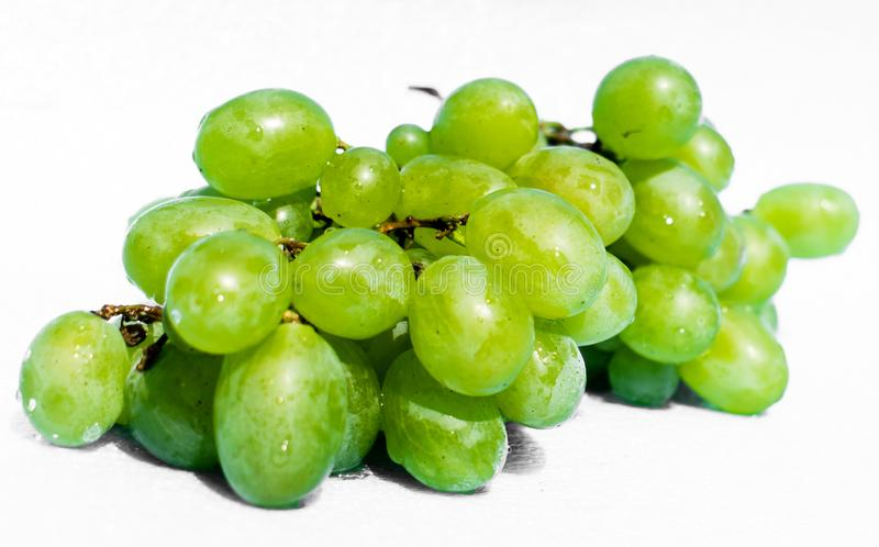 Bunches of grapes. Yellow and green grapes. Subject isolated on a white background royalty free stock photo
