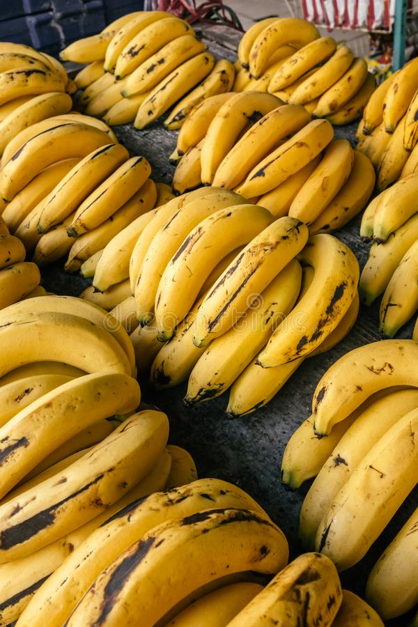 Bunches of ripe bananas on thai market stall. Top view fruit background royalty free stock photo