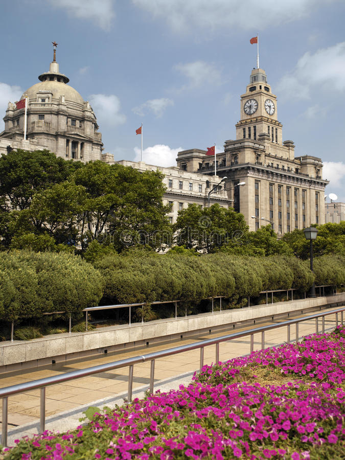 The Bund in Shanghai - China. The Bund in Shanghai in eastern China. The city is a tourist destination renowned for its historical landmarks such as the Bund and stock photos