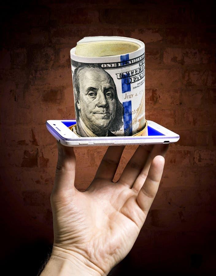 Bundel van dollarbankbiljetten van het scherm dat van smar worden getoond stock afbeeldingen