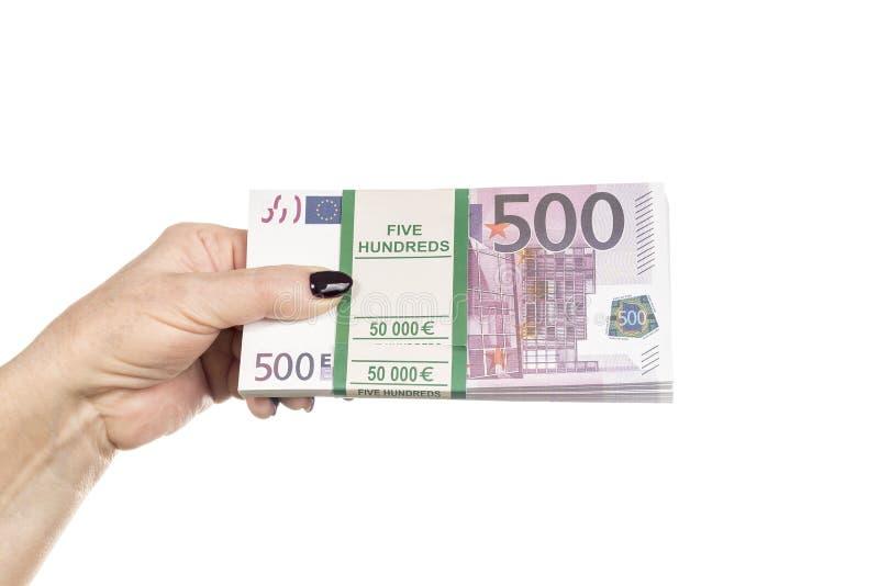 Bundel van euro geld in vrouwelijke hand royalty-vrije stock afbeeldingen
