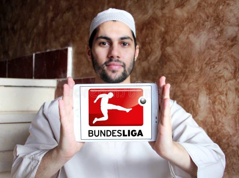 Bundesliga , german football league logo. Logo of bundesliga , german league on samsung tablet holded by arab muslim man royalty free stock image