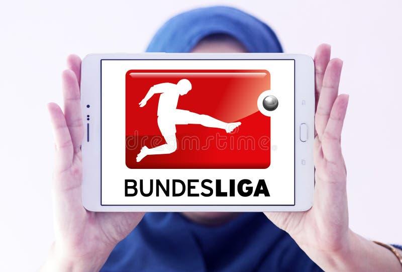 Bundesliga , german football league logo. Logo of bundesliga , german league on samsung tablet holded by arab muslim woman stock photo