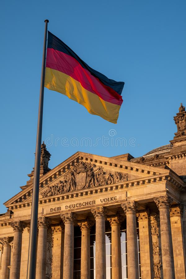 The Bundestag building, Parliament of the Federal Republic of Germany, with German flag flying outside. Photographed in the late afternoon during the June royalty free stock image